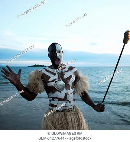 Tribesman looking angry on the beach