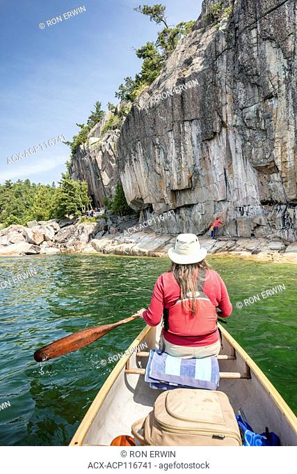 Viewing the Agawa Rock Pictographs from a canoe on Agawa Bay in Lake Superior Provincial Park, Ontario, Canada