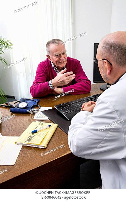 Medical practice, elderly patient talking to the doctor, Germany