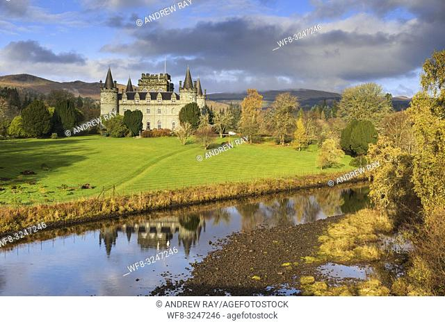 Inveraray Castle in Argyll and Bute, Scotland, reflected in the River Aray. The image was captured on a morning in late October from the bridge which carries...