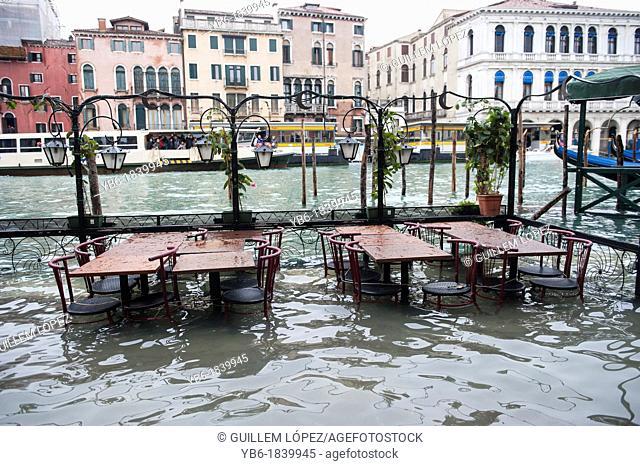 Empty terraces in the touristic restaurant near Rialto due the Acqua Alta, Venice, Italy