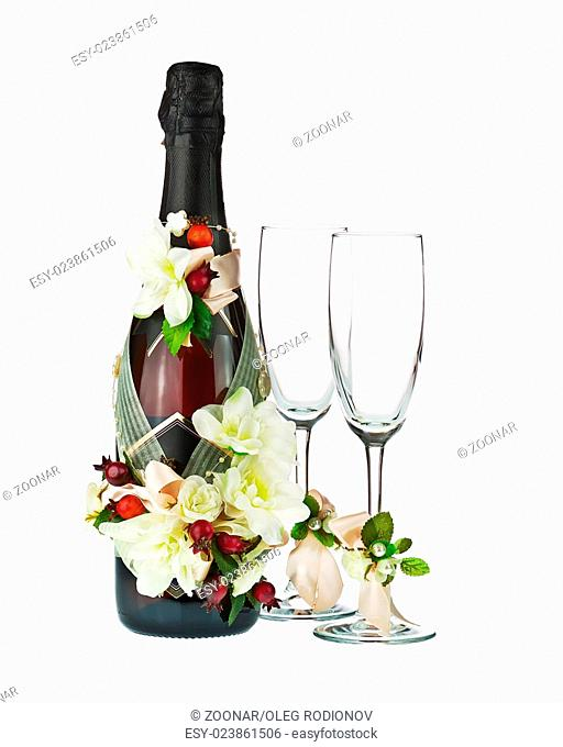 Champagne Bottle and Glass with Wedding Decoration of Flower Arrangements