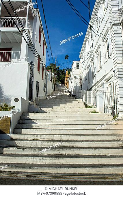 Stairs lerading up the hill between historic houses in Charlotte Amalie capital of St. Thomas, US Virgin Islands