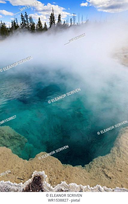 Steam and turquoise depths at Black Pool, dawn, West Thumb Geyser Basin, Yellowstone National Park, UNESCO World Heritage Site, Wyoming