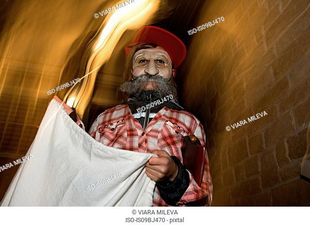Teenage boy dressed up as old man, blurred