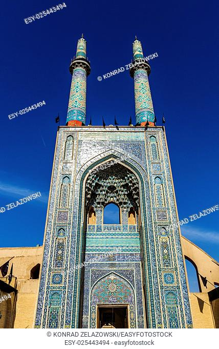 Main entrance and minarets of Grand Jame Mosque of Yazd city in Iran