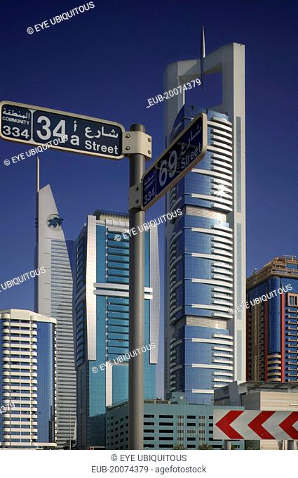 Modern architecture along Sheikh Zayed Road, with road sign
