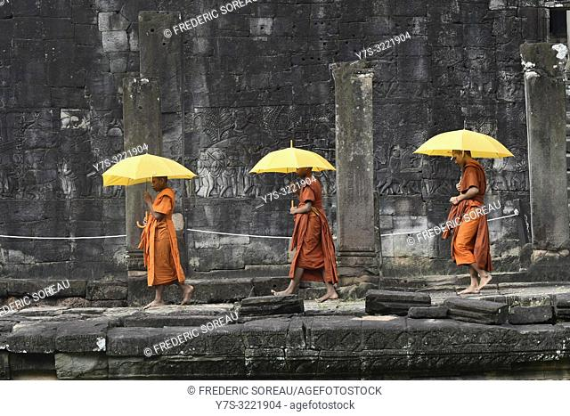 Buddhist monks at Bayon temple, Angkor Thom, Siem Reap, Cambodia, South east Asia