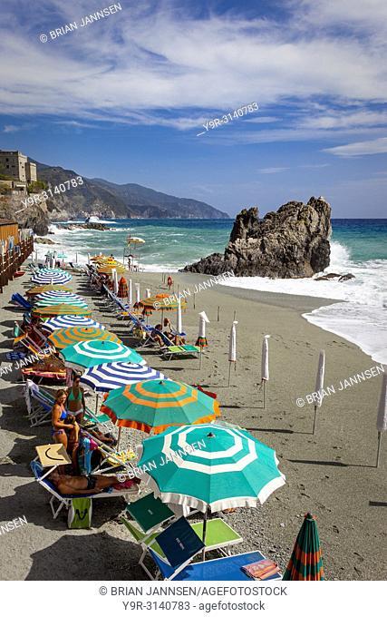 Colorful Umbrellas on the beach at Monterosso al Mare - one of the Cinque Terre, Liguria, Italy
