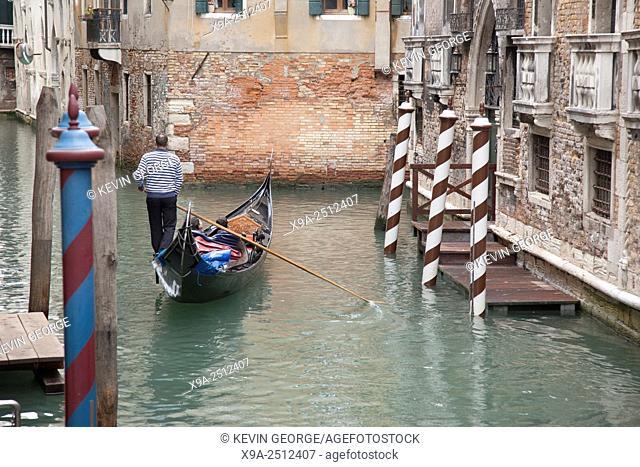 Traditional Venetian Gondola Boats on Canal, Venice; Italy