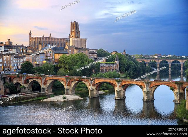 The Tarn River crossing Albi town. Pont Vieux bridge and the Church of Notre Dame du Breuil in Tarn village, Occitanie Midi Pyrenees France