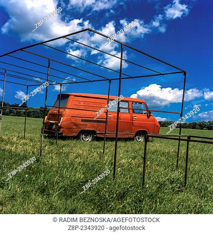 Red old van in the meadow, Czech Republic