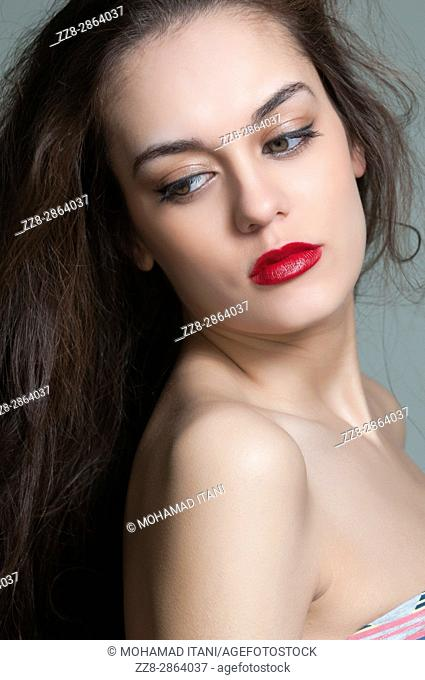 Beautiful young woman looking over shoulder