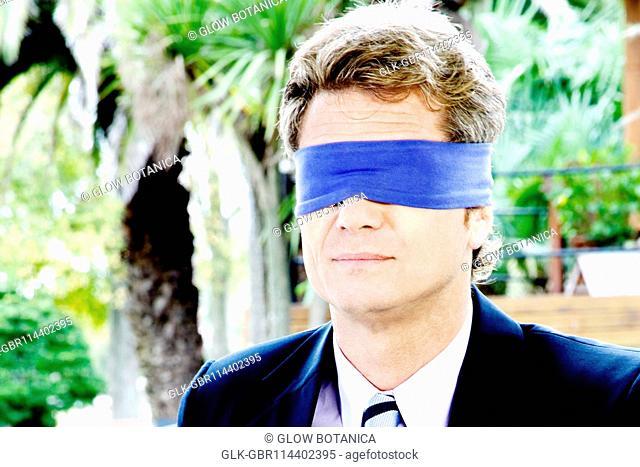 Close-up of a blindfolded businessman