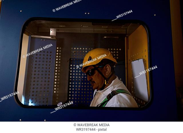 Engineer standing inside service lift