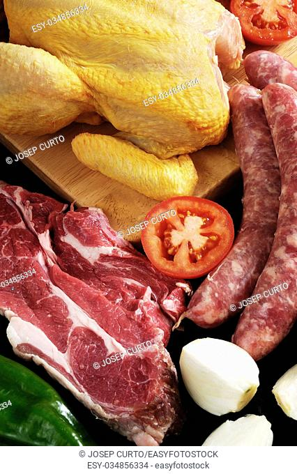 vegetables and meat with chicken and beef, with black background