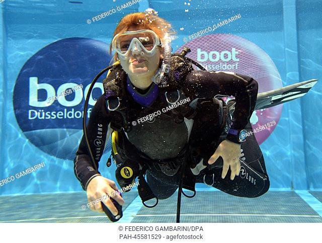 A divers pose for the photographers in Duesseldorf,Germany, 17January 2014. Around 1,650 exhibitors from 60 countries are taking part in the expo boot...