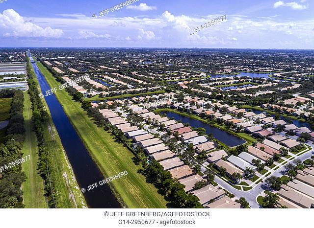 Florida, Boynton Beach, aerial overhead bird's eye view above, residential neighborhood houses homes, canal, water
