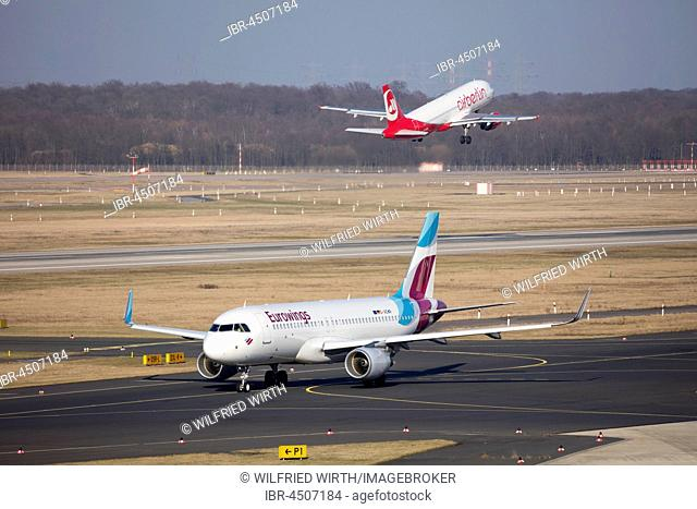 Aircraft euro Wings on Runway and Airberlin taking off, Düsseldorf Airport, Düsseldorf, North Rhine-Westphalia, Germany