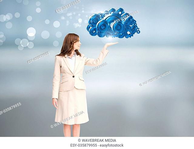 Businesswoman with open hand with cog gears