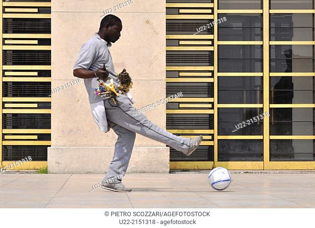 Paris, France, an African immigrant, souvenirs peddler, playing soccer by the Palais de Chaillot, Trocadero