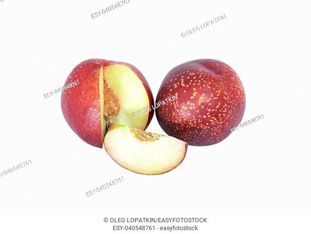 nectarine with a cut portion on a white background