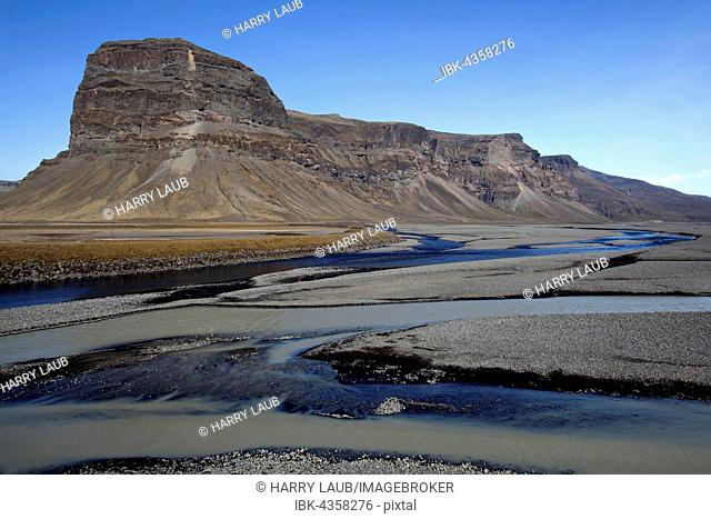 Glacial runoff permeate the volcanic sand plain Skeidararsandur, behind the rock massif Lomagnupur or Lómagnúpurur, Southern Region, Iceland