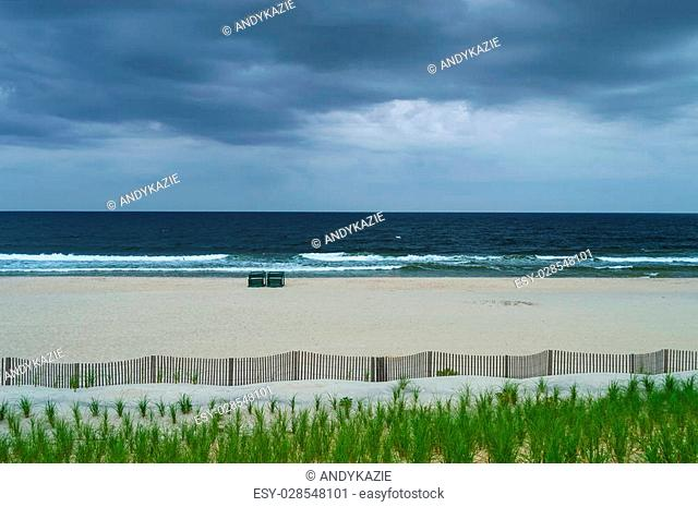 An empty beach on an overcast Summer day on Long Beach Island along the Jersey Shore