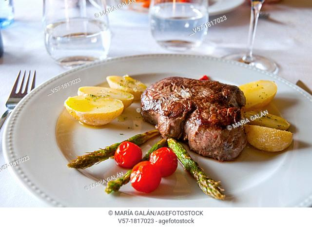 Beef steak with grilled vegetables. Close view