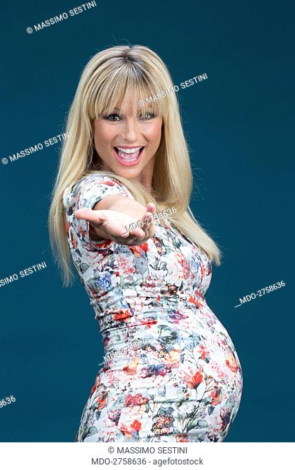 The presenter of Striscia la Notizia Michelle Hunziker posing pregnant for a photo shooting. Italy, Segrate. 10th September 2013