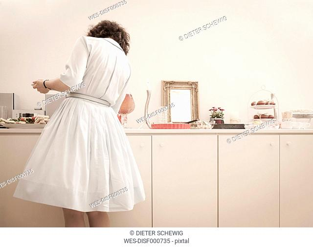 Young woman at the buffet on a retro style tea party