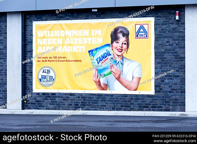 "09 December 2020, North Rhine-Westphalia, Essen: An advertising poster in hostoric design advertises the """"new oldest Aldi market"""""