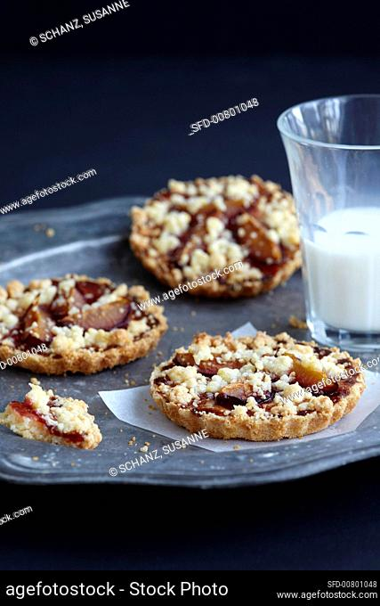Damson crumble cakes on a tin plate