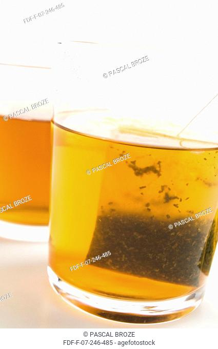 Close-up of two glasses of herbal tea