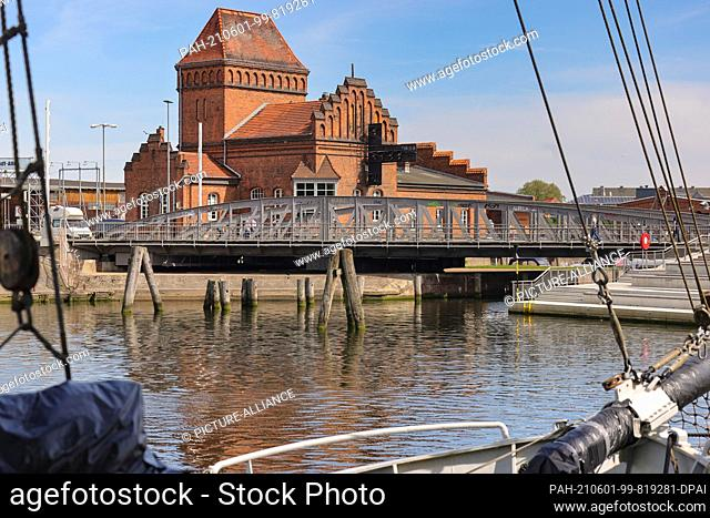 01 June 2021, Schleswig-Holstein, Lübeck: View of the harbour swing bridge in Lübeck. The listed bridge was extensively renovated in 2014 and is a landmark of...