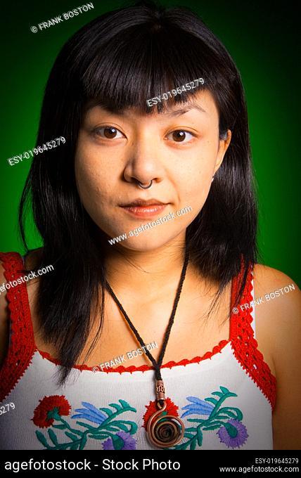 Portrait of a pierced Asiatic woman