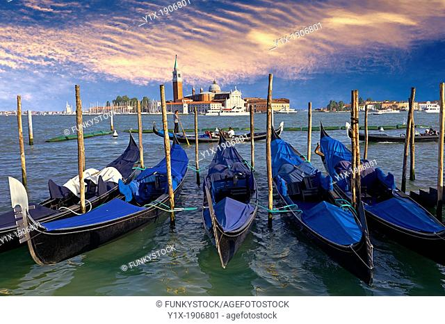 Gondolas at St Mark's Square with the island of San Giorgio Maggiore behind , with its church front designed by Andrea Palladio and begun in 1566  Venice Italy