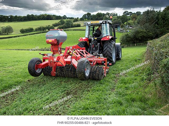 Tractor with Opico Sward Rejuvenator in grass field, Adfa, Newtown, Powys, Wales, September