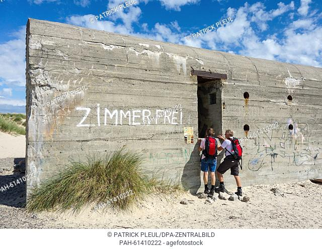 An old German World War Two shelter which says 'Zimmer frei', not far from the northernmost point where North and East Sea encounter in Grenen, Denmark
