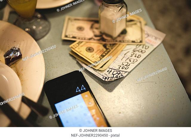 Banknotes and bill on table