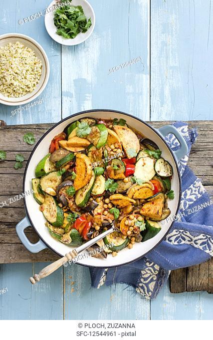 Tajine made of zucchini, eggplant, red pepper, sweet potato and chickpeas