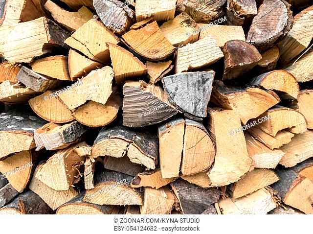 Stacked firewood in preparation for winter. Dry wood. Ideal for concepts and backgrounds