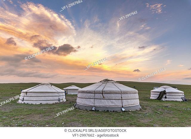 Mongolian nomadic traditional gers at sunset. Middle Gobi province, Mongolia