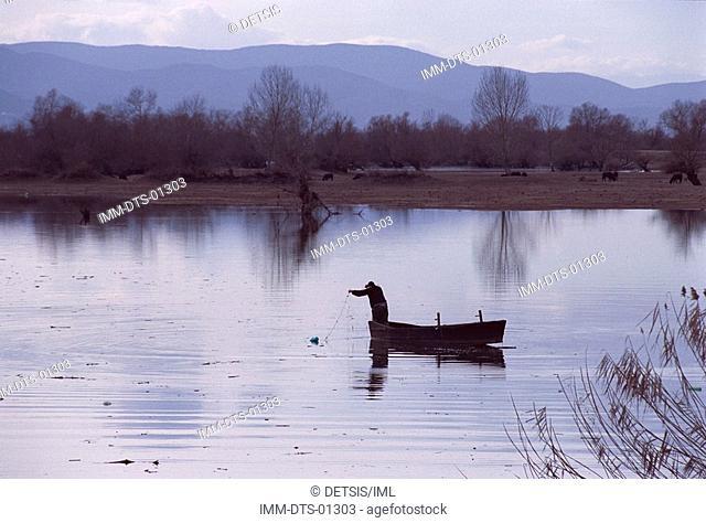 Fisherman on boat , Lake Kerkini  Macedonia, Greece