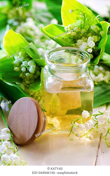 Perfumed lily of the valley oil in a bottle