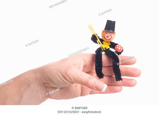 female hand holding a chimney sweep for luck