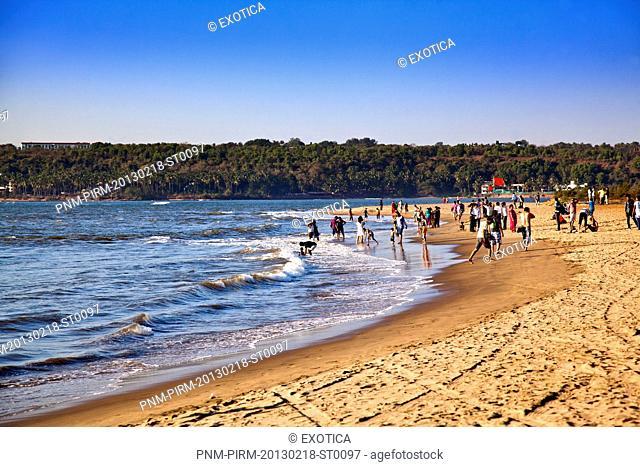 Tourists on the beach, Miramar Beach, Panaji, North Goa, Goa, India