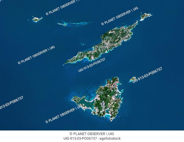 Satellite view of Anguilla and Saint-Martin islands. At north is Anguilla, a British overseas territory. Saint Martin is divided between France and the...