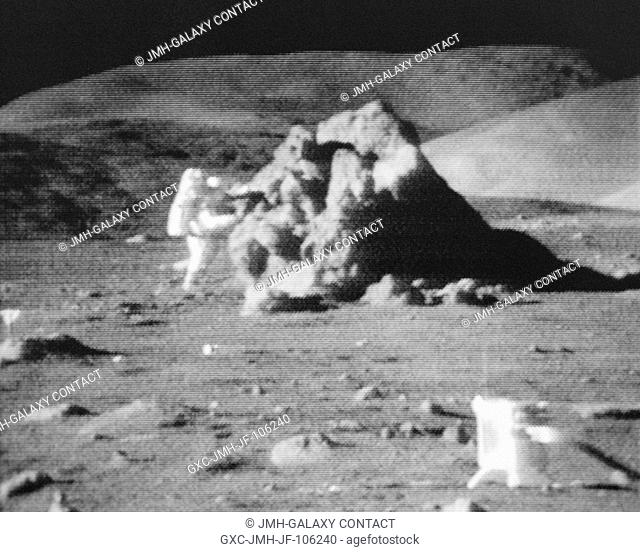 Scientist-astronaut Harrison H. Schmitt chips samples from a large boulder during the first Apollo 17 extravehicular activity (EVA) at the Taurus-Littrow...