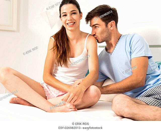 Young couple dating on a hotel bedroom